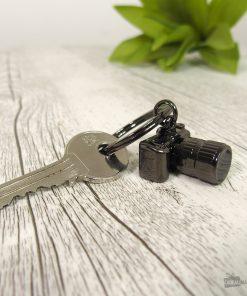 Ce porte-clés sera idéal pour ranger toutes vos clés avec classe ! Cet appareil photo reflex plaira aux passionnés de photographie.